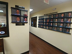 Instructor bios on the wall at Philadelphia's Online Trading Academy office